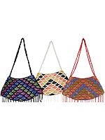 Lot of Three Boat Shaped Densely Beaded Handbags