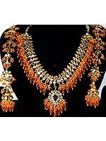 Bridal Kundan Necklace with Orange Glass Beads and Earwrap Jhumka Earrings