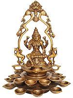Goddess Lakshmi with Multiple Diyas