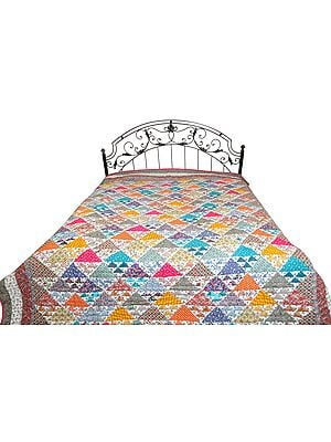 Multicolored Floral Printed Comforter from Dehradun with Triangular Patch-work and Kantha Stitch