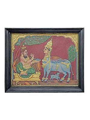 "22"" x 18"" Sage Vashishtha Eating the Food of Kamdhenu Tanjore Painting | Traditional Colors With 24K Gold | Teakwood Frame | Gold & Wood | Handmade | Made In India"