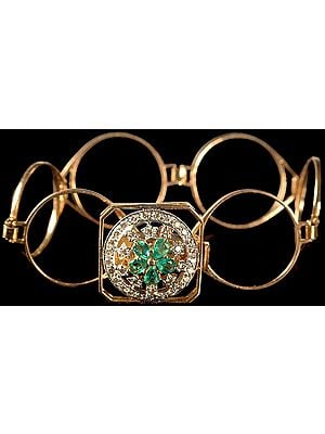 Finely Crafted Hoops Bracelet with Central Chakra of Faceted Emerald and Diamonds