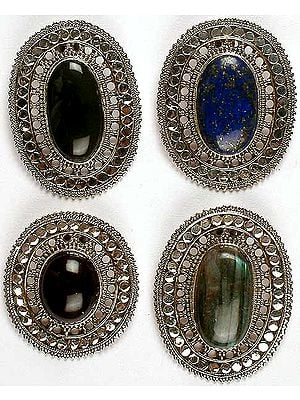Lot of Four Gemstone Pendants<br>(Black Onyx, Lapis Lazuli, Amethyst & Labradorite)