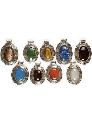 Lot of Nine Oval Gemstone Pendants with Filigree <br>(Labradorite, Malachite, Tiger Eye, Lapis Lazuli, Black Onyx, Blue Chalcedony, Amethyst, Carnelian & Rainbow Moonstone)