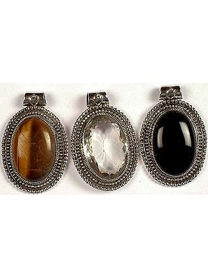 Lot of Three Oval Gemstone Pendants<br>(Tiger Eye, Faceted Crystal & Black Onyx)