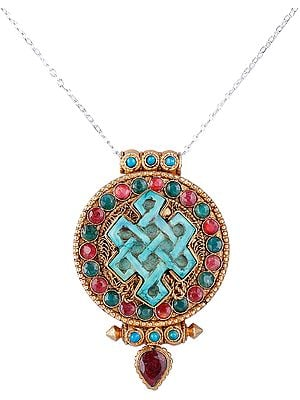 Gold Plated Filigree Gau Box Pendant with Ruby Coral and Endless Knot Shaped Turquoise