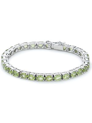 Superfine Sterling Silver Chain Bracelet with Oval-Cut Faceted Peridot Stones