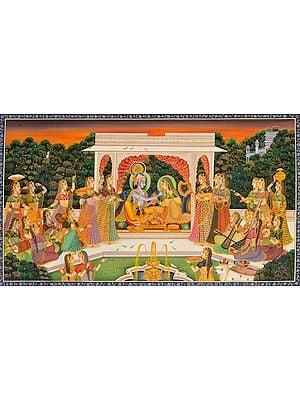 Krishna Feeding a Coy Radha