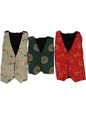 Lot of Three Sikkimese Brocaded Sleeveless Jackets
