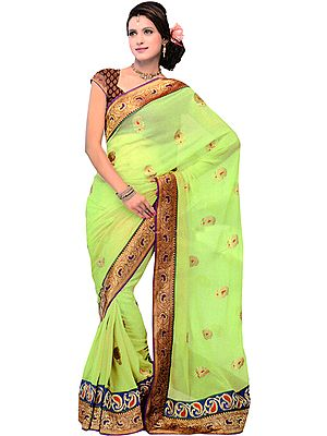 Foliage-Green Designer Wedding Sari with Metallic Thread Embroidered Booties and Patch Border