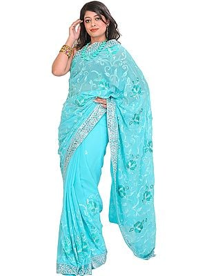 Blue-Curacao Sari with Floral Embroidery and Sequined Patch Border
