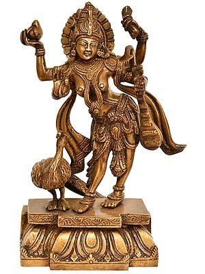 Goddess Saraswati Standing in Tribhanga with a Peacock
