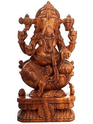 Seated Ganesha in Polished Wood Finish