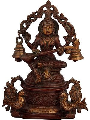 Goddess Saraswati Seated on High Pedestal with Hanging Bells