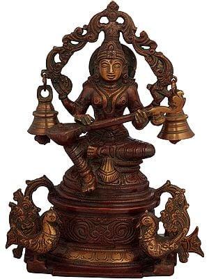 Goddess Saraswati Seated on High Pedestal with Hanging Bells