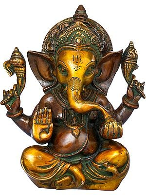 Lord Ganesha Enjoying Modak