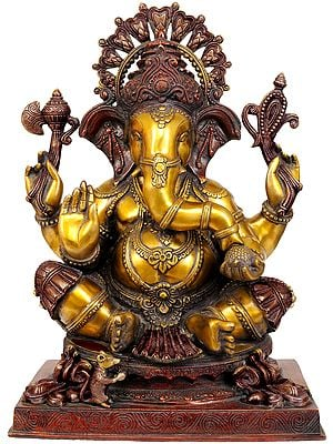 Four Armed  Ganesha Enjoying Modak
