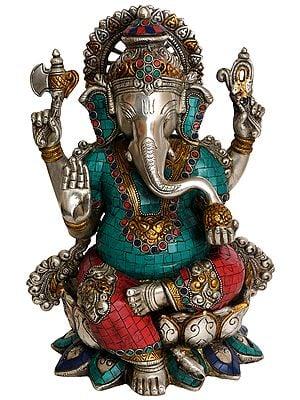 Lord Ganesha eating a Laddoo