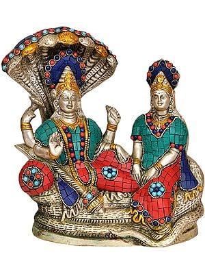 Vishnu with Lakshmi Ji on Sheshanaga