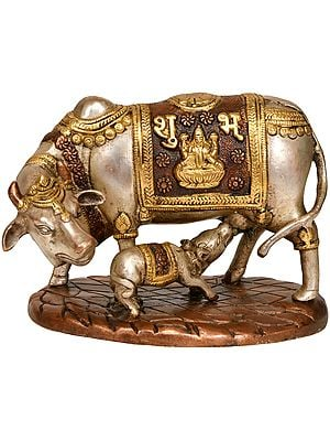 Cow and Calf: Saddle Decorated with Lakshmi-Ganesha
