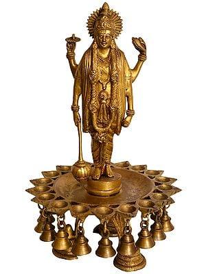 Lord Vishnu Wick Lamp with Hanging Bells