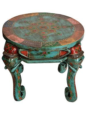 Decorated Table with Elephant Head Legs
