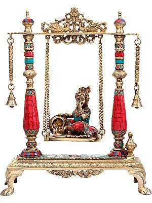 Butter Krishna on a Swing