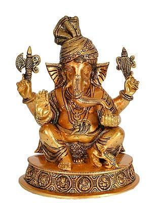 Turbaned Ganesha Enjoying Modak