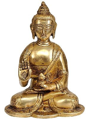 Seated Buddha, His Hand Raised In Blessing