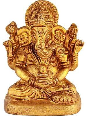 Lord Ganesha Holding a Shiva Linga (Small Sculpture)