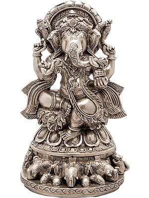 Lord Ganesha Seated on Three Elephant Heads