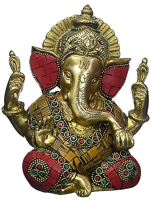 Seated Ganesha, His Adorable Haloed Head Tilted To A Side
