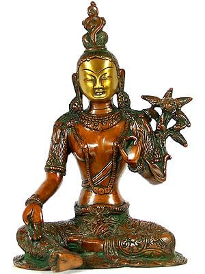 Seated Green Tara, Her Towering Crown In Sharp Contrast To Her Dangling Karnaphool