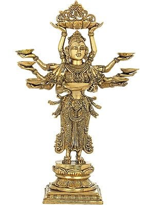 The Ten Armed Auspicious Deepalakshmi With Each Hand Holding A Lamp