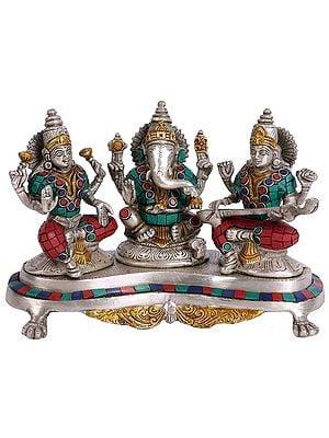 Lord Ganesha with Goddess Lakshmi and Saraswati
