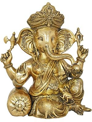 Four Armed Crowned Seated Ganesha With Cushion