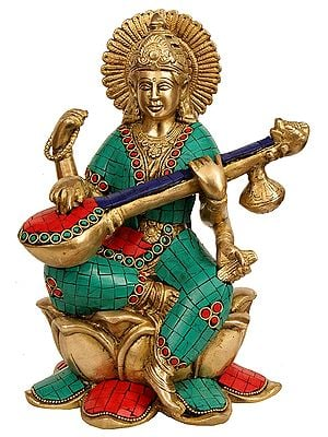 Goddess Sarawati Seated on Lotus and Playing Veena