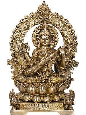 Goddess Saraswati Seated On Lotus Seat With Kirtimukha Aureole