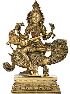 The Enchanting Devi Sarasvati Seated On Her Peacock