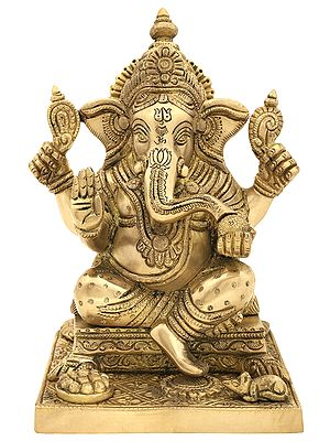 Modak Eating Lord Ganesha Seated on a Pedestal