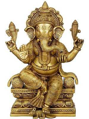 Ganesha in Carved Vastra Seated on Cushion Chowki