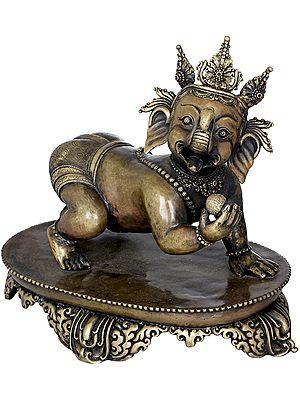 Crawling Baby Ganesha with a Modak in Hand