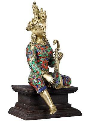 Devi Saraswati Seated on Wooden Pedestal