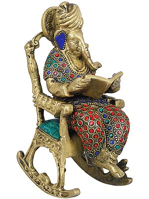 Ganesha on Recliner Reading The Mahabharata