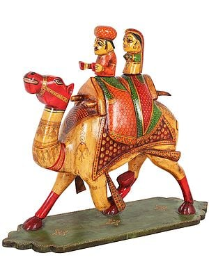 Tribal Couple Riding on a Camel