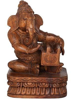 Musician Ganesha Playing Harmonium