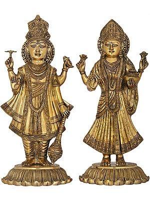 Standing Lord Vishnu And Devi Lakshmi On Upturned Lotus Blooms
