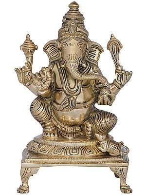 Lord Ganesha in Royal Ease Posture Seated on a Chowki