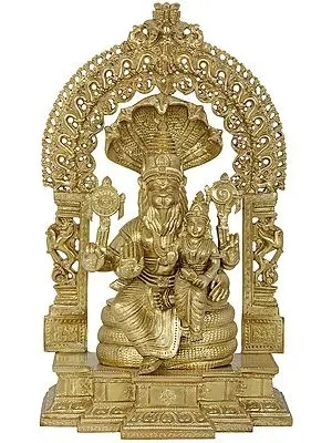 Lord Narasimha with Goddess Lakshmi on a stylized Kirtimukha Throne (Hoysala Art)