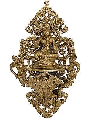 Chatubhujadharini Devi Lakshmi Poised Within A Network Of Vines